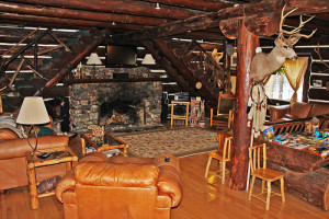 The original stone fireplace of the Historic Tamarack is the perfect place to warm up after a day in the snow.